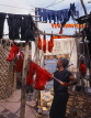MOROCCO, Marrakesh, Medina (old town), man drying coloured wool, MOR311JPL
