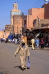 MOROCCO, Marrakesh, Medina (old town) street and women in traditional dress, MOR146JPL