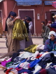 MOROCCO, Tafroute, Souk in mountain village, Berber people trading clothing, MOR378JPL