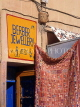 MOROCCO, Tiznit, shop advertising Berber goods and jewellery, MOR375JPL