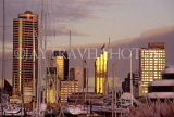 NEW ZEALAND, North Island, AUCKLAND, sunset over city and yacht harbour, NZ16JPL