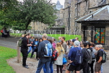 SCOTLAND, Edinburgh, visitors on free walking tour with guide, SCO953JPL