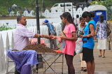 SRI LANKA, Kandy, Kandy lakeside, fruitseller, people buying Velvet Tamarind (Gal Siyambala), SLK3955JPL