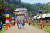SRI LANKA, Kandy, Temple of the Tooth (Dalada Maligawa), visitors and Buddhist flags on walkway, SLK3345JPL