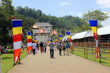 SRI LANKA, Kandy, Temple of the Tooth (Dalada Maligawa), visitors and Buddhist flags on walkway, SLK3346JPL