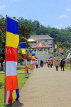 SRI LANKA, Kandy, Temple of the Tooth (Dalada Maligawa), visitors and Buddhist flags on walkway, SLK3348JPL