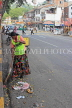 SRI LANKA, Kandy, town centre, road sweeper with traditional broom, SLK3658JPL