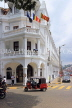 SRI LANKA, Kandy, town centre, three wheeler taxi going past Queens Hotel, SLK3867JPL