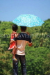 SRI LANKA, Kandy area, father and daughter, with umbrella under mid day sun, SLK2495JPL