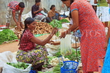 SRI LANKA, Negombo, market, fruit and vegetable market, vendor and shopper, SLK2712JPL