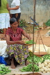 SRI LANKA, Negombo, market, fruit and vegetable market, vendor weighing Okra with scales, SK2715JPL