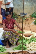 SRI LANKA, Negombo, market, fruit and vegetable market, vendor weighing Okra with scales, SK2716JPL