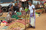 SRI LANKA, Negombo, market, fruit and vegetable market, vendor with scales, and shopper, SLK2706JPL