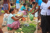 SRI LANKA, Negombo, market, fruit and vegetable market, vendor with scales and shopper, SLK2702JPL