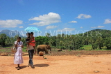 SRI LANKA, Pinnewala Elephant Orphanage, visiting family at site, SLK2408JPL