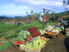 SRI LANKA, hill country, Nuwara Eliya, roadside vegetable stall and tea plantations, SLK154JPL