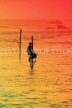 SRI LANKA, south coast, Ahangama area, Stilt Fisherman, dusk, sunset, SLK4748JPL