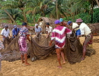 SRI LANKA, south coast, Ambalangoda, fishermen sorting net after catch, SLK1583JPL