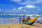 SRI LANKA, south coast, Bentota, catamaran and fishermen on beach, SLK1685JPL