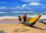 SRI LANKA, south coast, Bentota, catamaran and fishermen on beach, SLK2135JPL