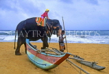 SRI LANKA, south coast, beach, and child on elephant ride, SLK183JPL