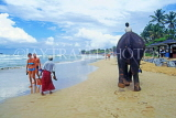 SRI LANKA, west coast, beach with tourists and boy on elephant ride, SLK2021JPL