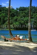 ST LUCIA, Marigot Bay, Marigot Beach resort, couple on sunbeds, STL639JPL
