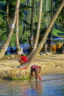 ST LUCIA, Marigot Bay, boy cleaning fish, STL737JPL