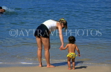 ST LUCIA, Marigot Bay, tourist and child, on beach, STL646JPL