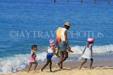 ST LUCIA, Reduit Beach, St Lucian family walking along beach, STL778JPL