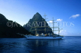 ST LUCIA, cruiser with sails, passing by The Pitons, STL604JPL