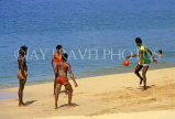 ST LUCIA, locals palying on beach, STL695JPL