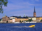 SWEDEN, Stockholm, Old Town (Gamla Stan), skyline and speed boat, SWE108JPL