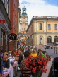 SWEDEN, Stockholm, Old Town Square (Gamla Stan Stortorget), cafe scene and Cathedral Tower, SWE119JPL