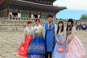 South Korea, SEOUL, Gyeongbokgung Palace, visitors in Hanbok attire posing for photos, SK351JPL