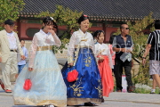 South Korea, SEOUL, Gyeongbokgung Palace, visitors in traditional Hanbok attire, SK460JPL