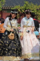 South Korea, SEOUL, Gyeongbokgung Palace, visitors in traditional Hanbok attire, SK464JPL
