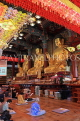 South Korea, SEOUL, Jogyesa Temple, golden Buddha statues and worshippers, SK288JPL