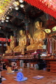 South Korea, SEOUL, Jogyesa Temple, golden Buddha statues and worshippers, SK289JPL