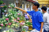 THAILAND, Bangkok, GRAND PALACE (Wat Phra Keo), worshipper and floral offerings, THA45JPL