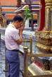 THAILAND, Bangkok, GRAND PALACE (Wat Phra Keo), worshipper at a shrine, THA1979JPL