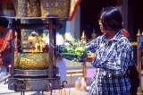 THAILAND, Bangkok, GRAND PALACE (Wat Phra Keo), worshipper with flower offerings, THA992JPL