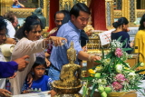 THAILAND, Bangkok, GRAND PALACE, worshippers bathing Buddha image, Songkran (New Year), THA06JPL