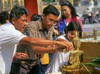 THAILAND, Bangkok, GRAND PALACE, worshippers bathing Buddha image, Songkran (New Year), THA729JPL