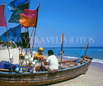 THAILAND, Hua-Hin, beach scene with fishermen sorting out nets on boat, THA1754JPL