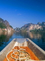 THAILAND, Khao Sok National Park, karst peaks reflected in Chao Lan Lake and boat, THAJPL