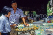 THAILAND, Ko Samui Island, market stall selling grilled cuttlefish on skewers, THA1976JPL