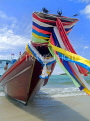 THAILAND, Koh Phangan Island, beach and longtail boat draped in good luck ribbons, THA2024JPL