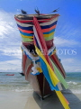 THAILAND, Koh Phangan Island, beach and longtail boat draped in good luck ribbons, THA2025JPL
