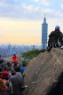 Taiwan, TAIPEI, Elephant Mountain, visitors viewing Taipei 101 from peak, at dusk, TAW450JPL